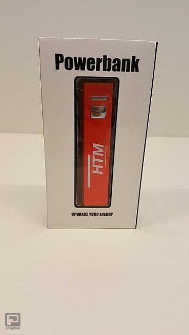 HTM relatiegeschenk, powerbank klein (rood) met HTM logo
